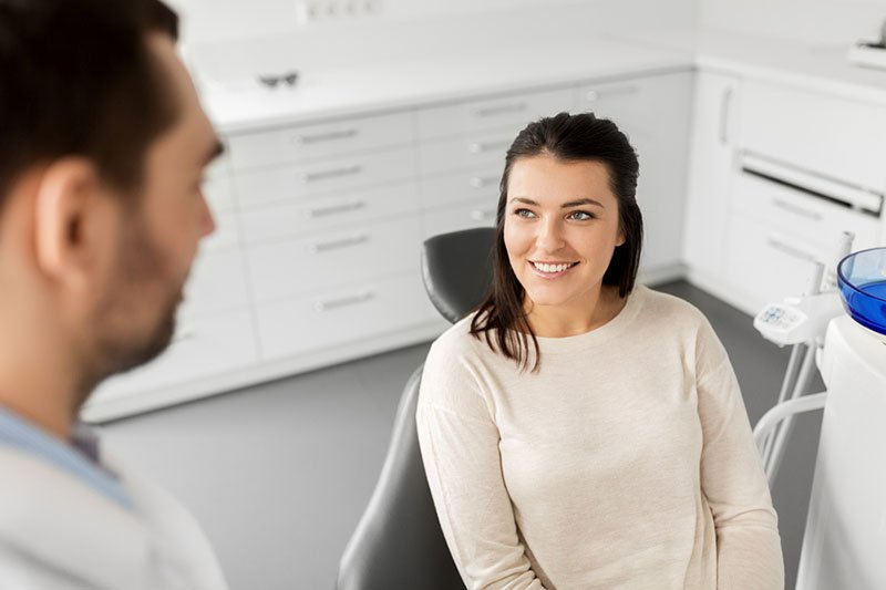 Woman talking to dentist